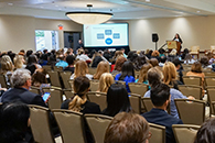 Thumbnail of: Attendees Listening to Presentation