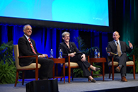 Thumbnail of: Senior Investment Managers Sitting and Smiling on Stage