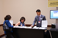 Thumbnail of: Three People at Exhibit Booth