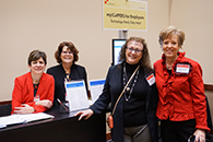 Thumbnail of: Four Women Standing and Smiling at my|CalPERS Exhibit Booth