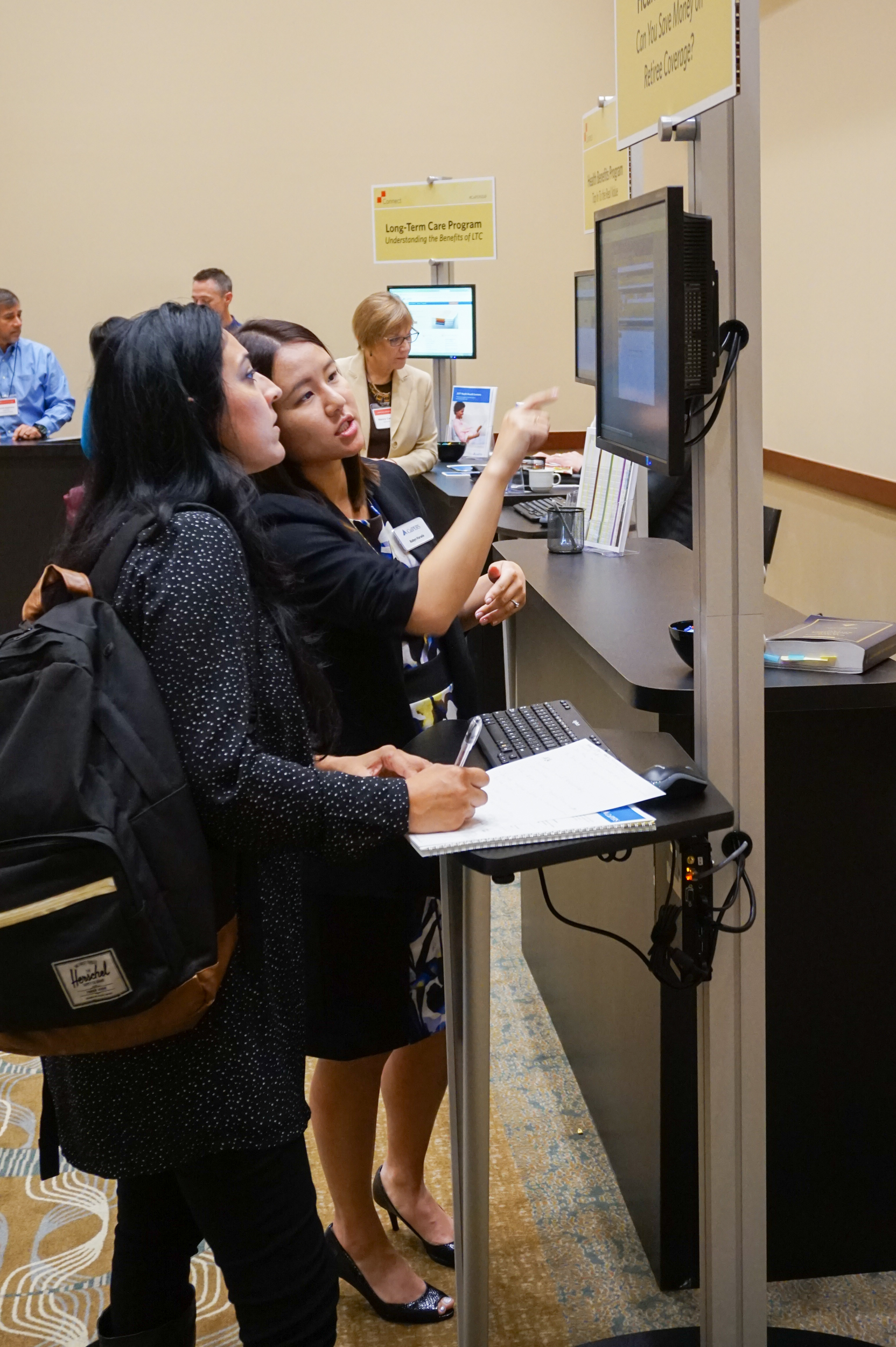 Thumbnail of: Staff Assisting Attendee at Computer with my|CalPERS