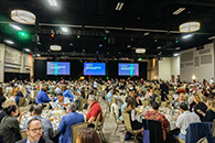 Thumbnail of: Attendees Eating Lunch in Conference Hall