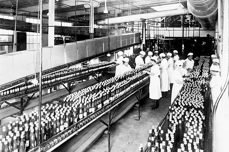 Workers in a catsup bottling plant